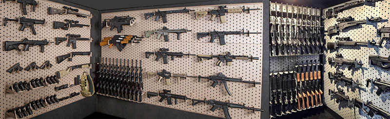 Tactical wall storage rack with guns