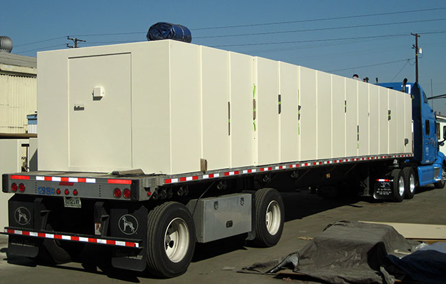 Tornado shelter safe rooms on truck for delivery to Oklahoma